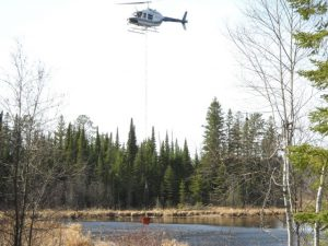 Helicopter dipping water