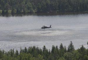 Blackhawk dipping water