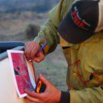 firefighter-checks-map-during-lake-hattie-fire-2016
