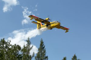 green-valley-fire-cl215-dropping-water-over-pine-trees