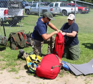 Firefighters packing gear